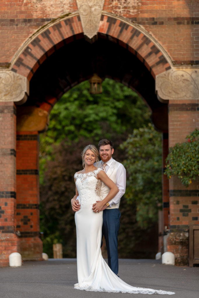bride groom formal portrait under archway the elvetham gardens hartley wintney hampshire oxfordshire wedding photographer