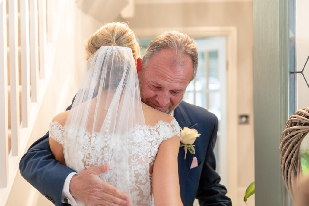 23 father of bride hugs daughter the elvetham hartley wintney hampshire oxfordshire wedding photographerss dress the elvetham hartley wintney hampshire oxfordshire wedding photographer
