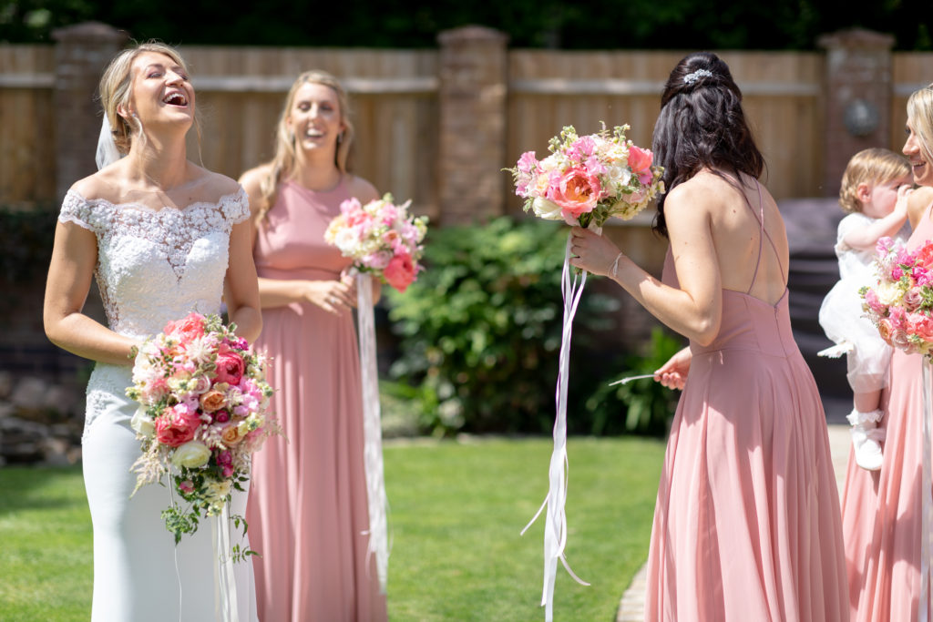 24 laughing bride bridesmaids floral bouquets the elvetham hartley wintney hampshire oxfordshire wedding photography