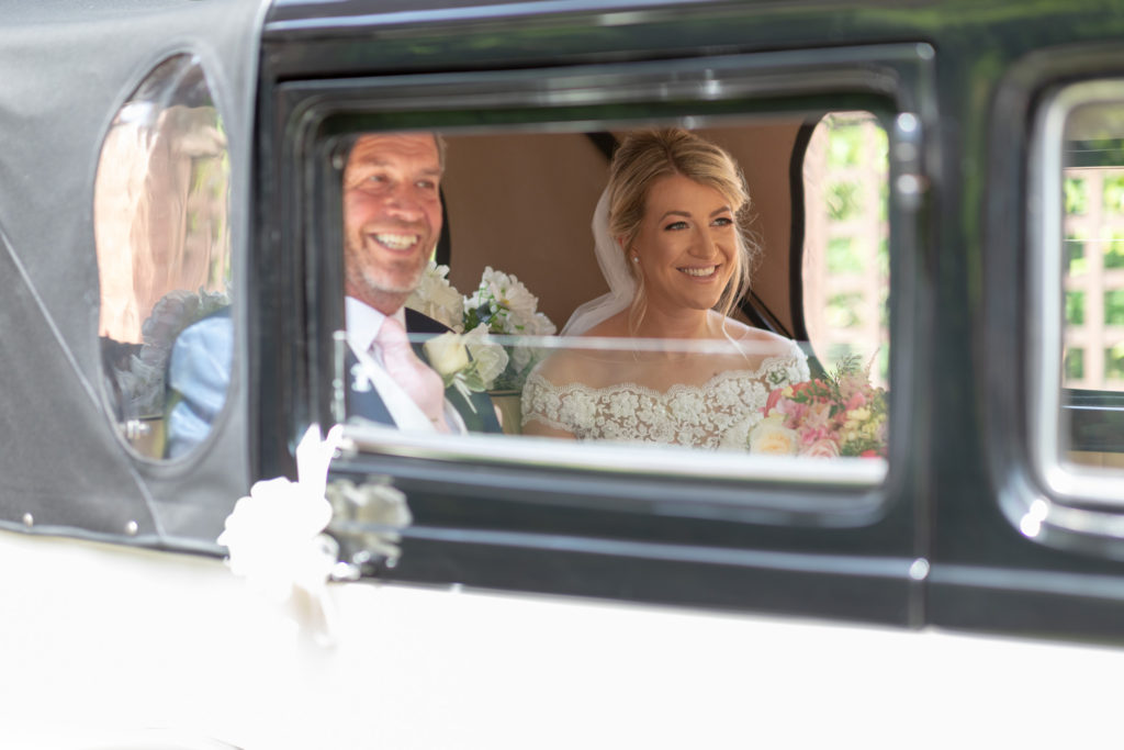 30 smiling father of bride daughter open bridal car the elvetham hartley wintney hampshire oxfordshire wedding photography