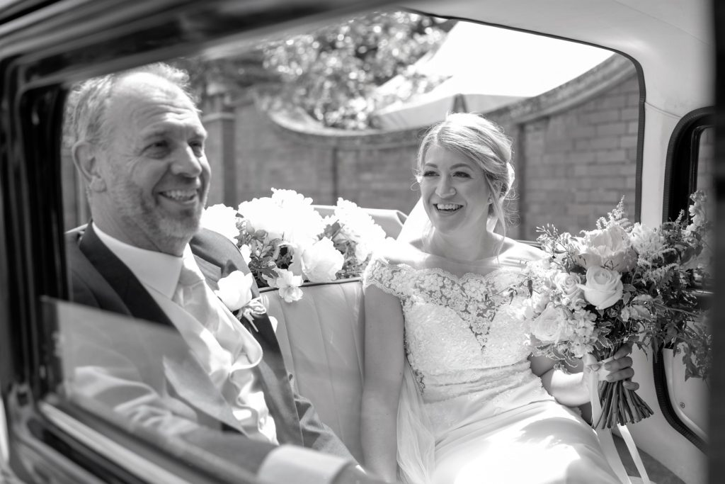 31 open bridal car arrives the elvetham hartley wintney hampshire oxford wedding photographers