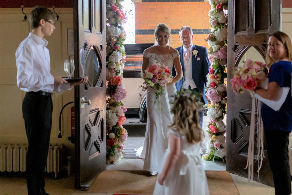33 flower girl greets bride father of bride the elvetham hartley wintney hampshire oxford wedding photography