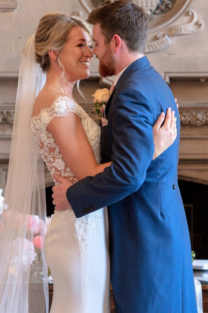 50 bride groom embrace marriage ceremony the elvetham hartley wintney hampshire oxford wedding photographers