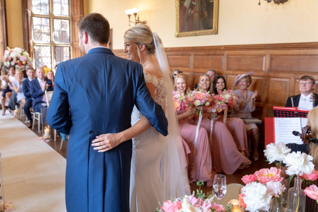 53 just married bride groom face ceremony guests the elvetham venue hartley wintney hamphire oxfordshire wedding photographers