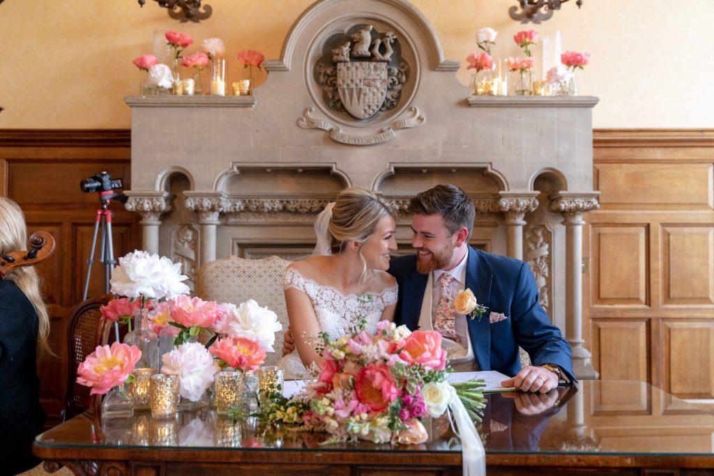 55 smiling bride groom after signing register the elvetham hartley wintney hampshire oxford wedding photographer