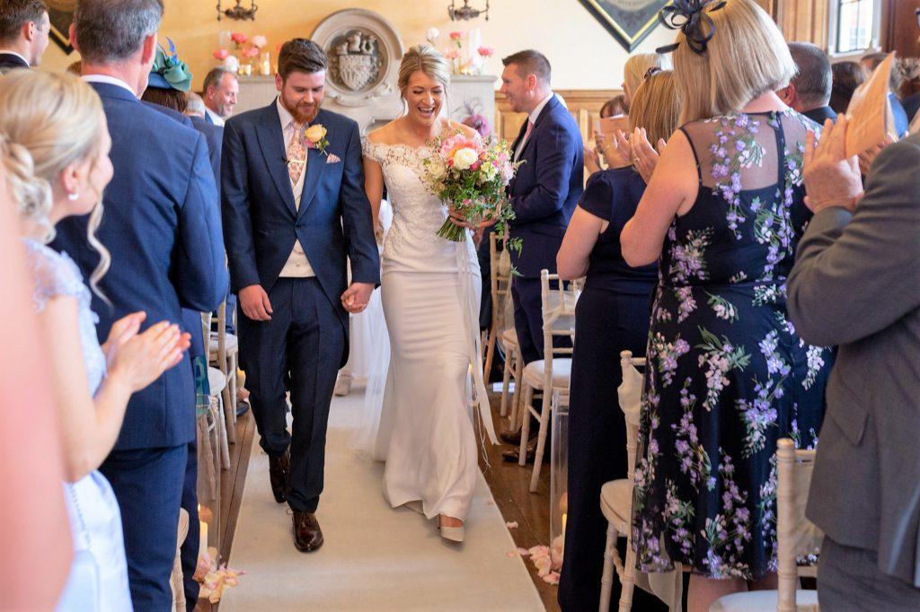 56 bride groom walk down aisle the elvetham venue hartley wintney hampshire oxford wedding photographers
