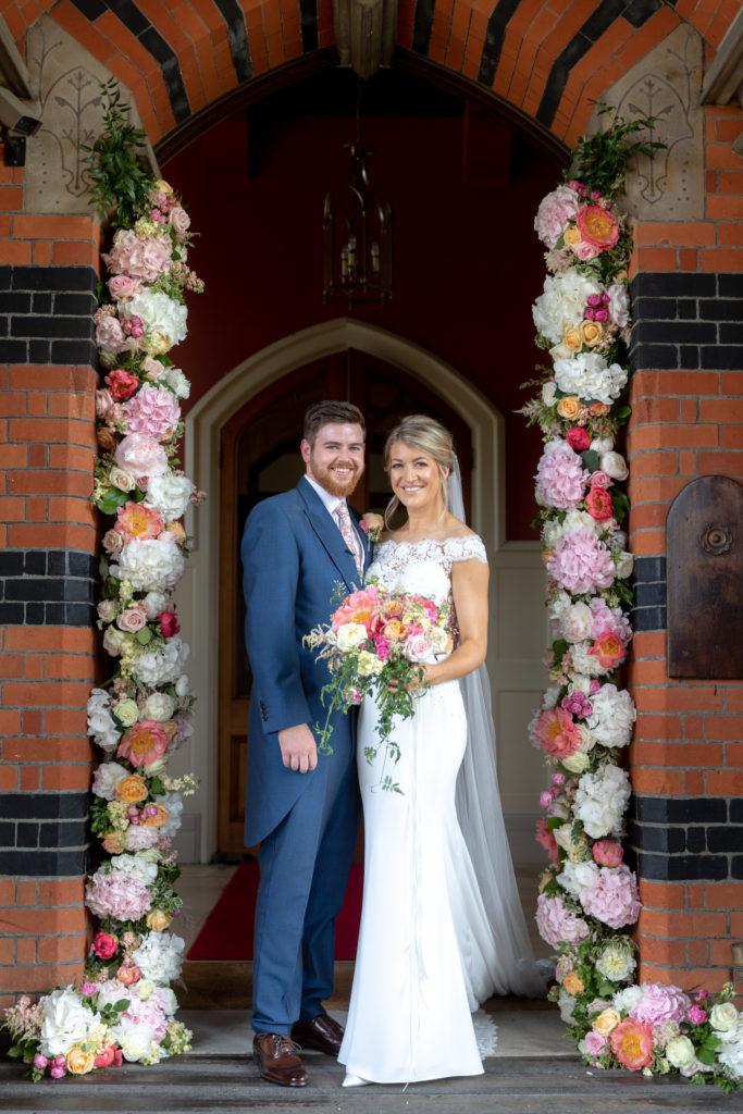 58 bride groom floral arch formal portrait the elvetham hartley wintney hampshire oxfordshire wedding photographer