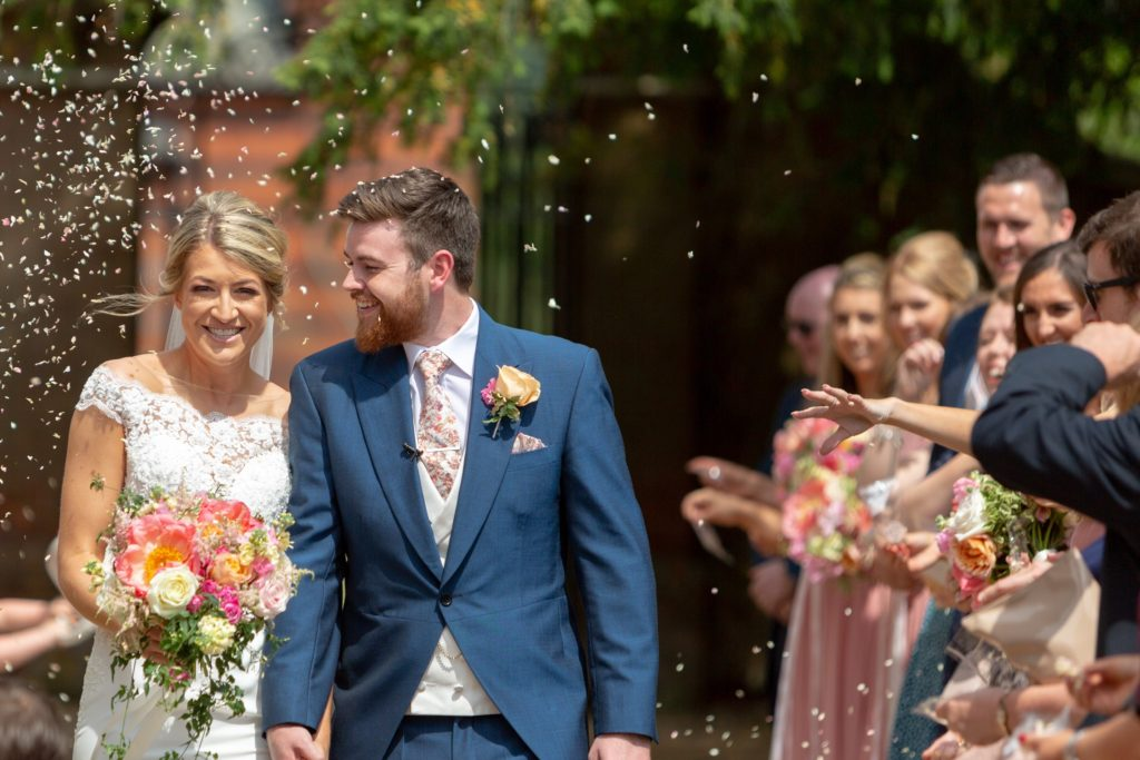 60 smilling bride groom bridesmaids confetti shower the elvetham hartley wintney hampshire oxfordshire wedding photography