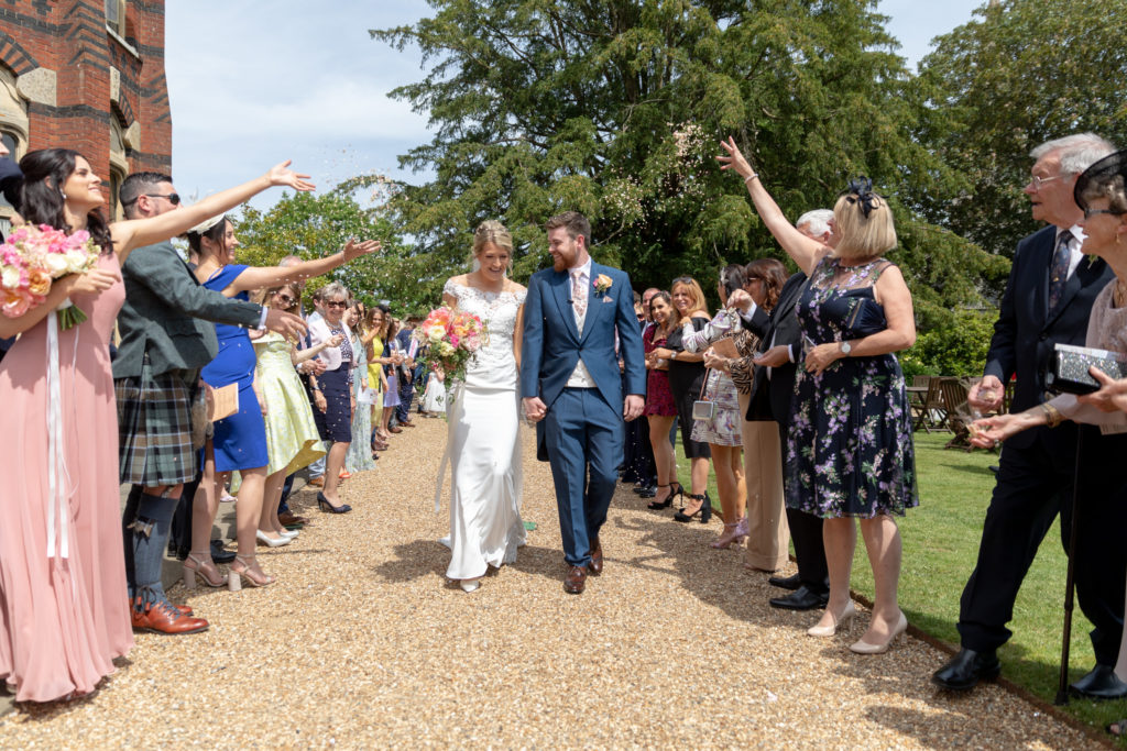 61 bride groom guests throw confetti the elvetham hartley wintney hampshire oxford wedding photographer