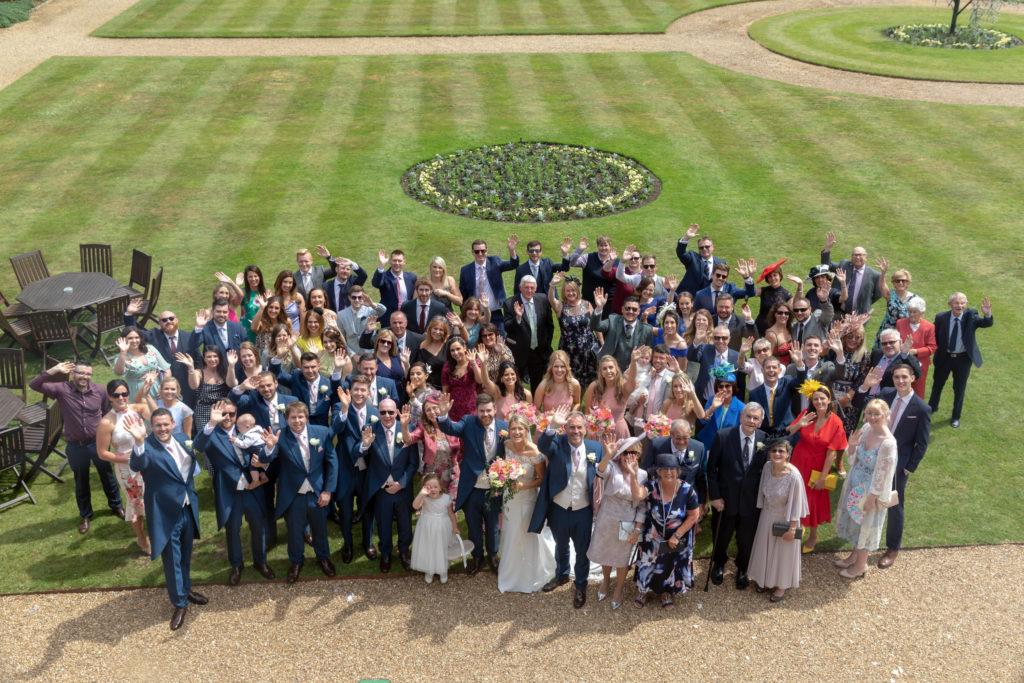 62 wedding reception guests wave the elvetham gardens hartley wintney hampshire oxford wedding photographers