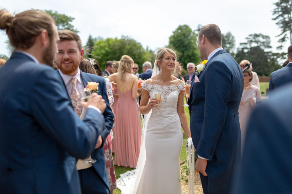 63 bride groomsmen champagne reception the elvetham grounds hartley wintney hampshire oxford wedding photography