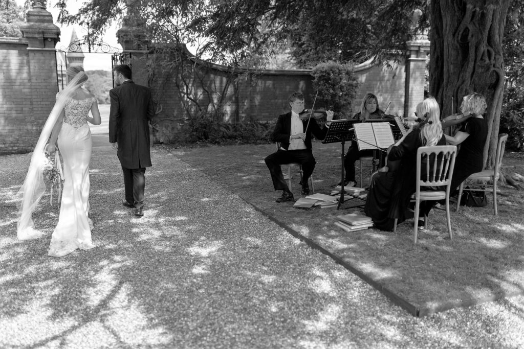 64 bride groom string quartet the elvetham gardens hartley wintney hampshire oxfordshire wedding photographer