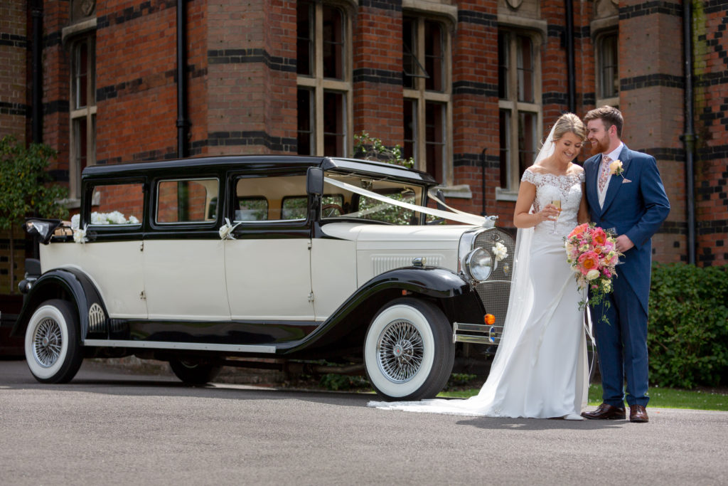 65 bride groom opentop bridal car the elvetham venue hartley wintney hampshire oxfordshire wedding photographers