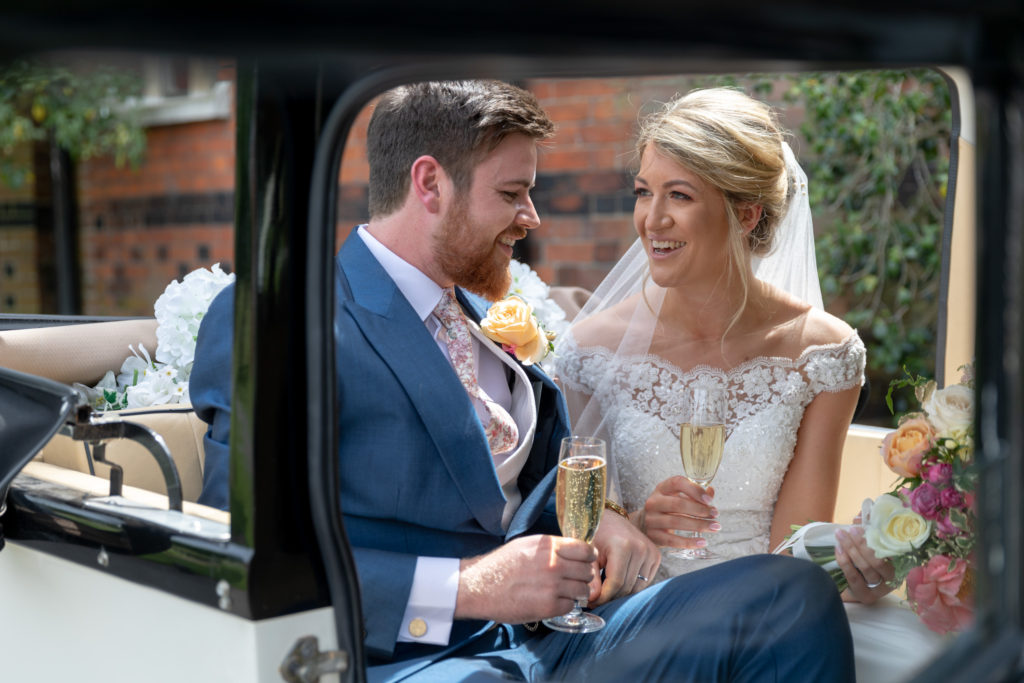 66 bride groom drink champagne open bridal car the elvetham grounds hartley wintney hampshire oxfordshire wedding photography