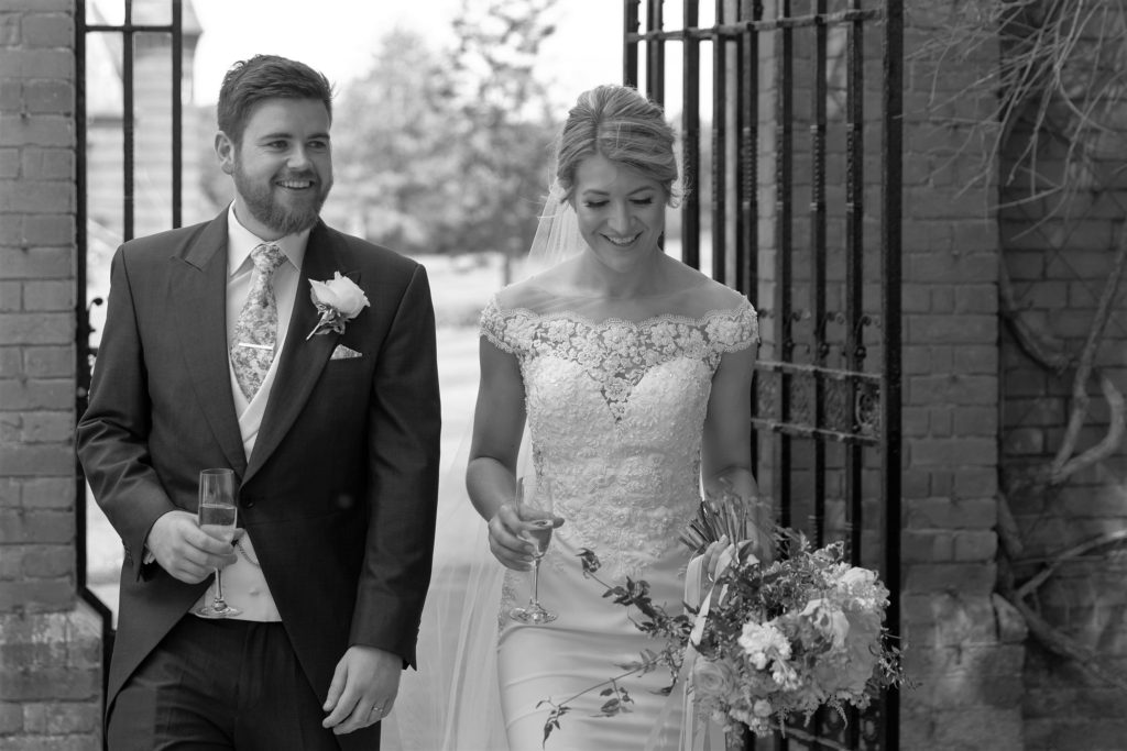 71 bride groom walk through ornamental gates the elvetham grounds hartley wintney hampshire oxfordshire wedding photographers