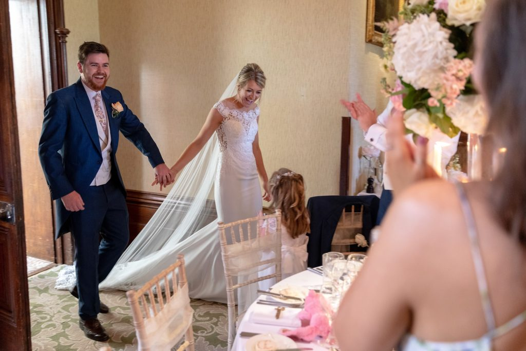 78 flower girl greet bride groom reception dinner the elvetham hartley wintney hampshire oxfordshire wedding photography
