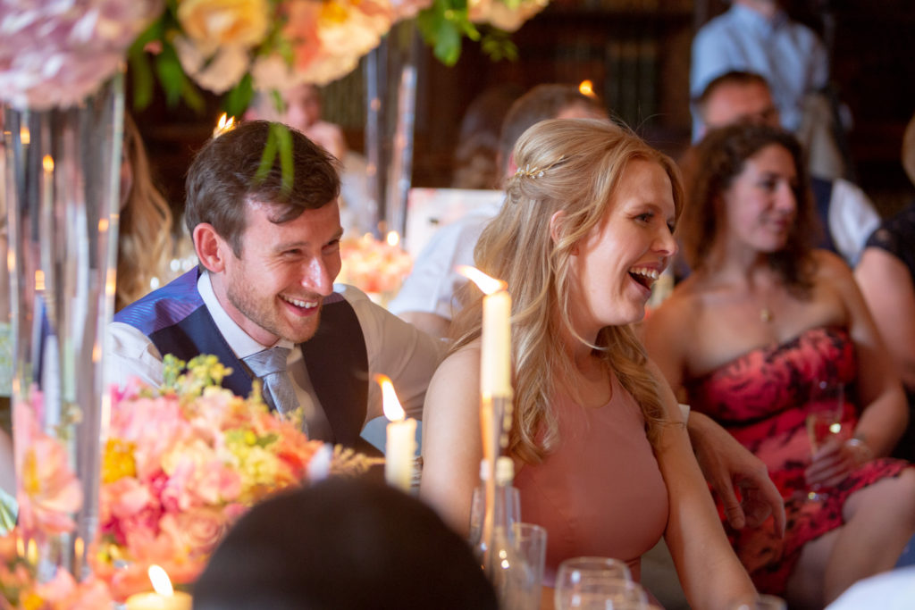 82 reception guests laugh top table speech the elvetham hartley wintney hampshire oxfordshire wedding photographer