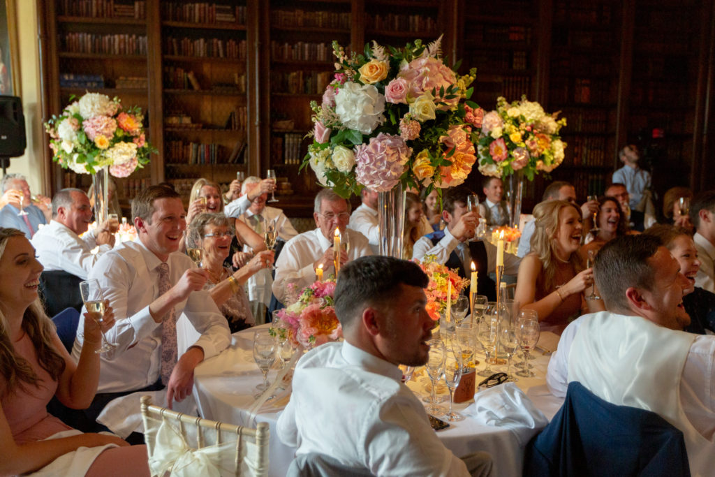 83 reception dinner guests toast bride groom the elvetham hartley wintney hampshire oxfordshire wedding photographers