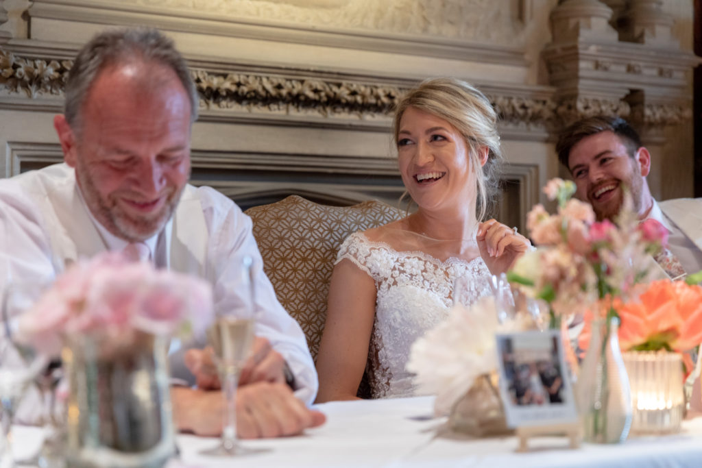 88 laughing father of bride groom bride dinner reception the elvetham harley wintney hampshire oxfordshire wedding photographer