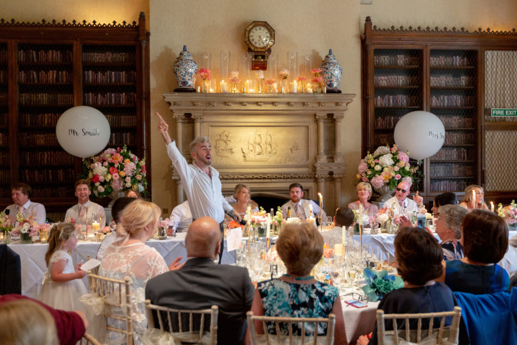 90 singing waiter entertains dinner reception guests the elvetham harley wintney hampshire oxfordshire wedding photography