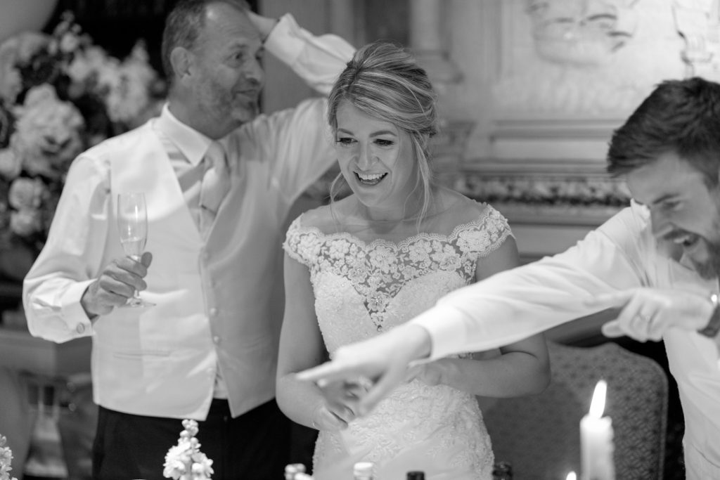 91 singing waiter entertains father of bride daughter groom dinner reception the elvetham harley wintney hampshire oxford wedding photographer