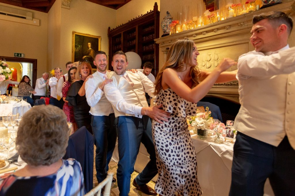 92 conga dancing dinner reception guests the elvetham venue hartley wintney hampshire oxford wedding photographers