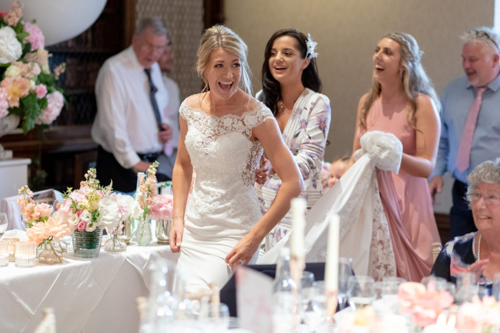 94 bride leads conga dancing reception dinner the elvetham hartley wintney hampshire oxfordshire wedding photographer