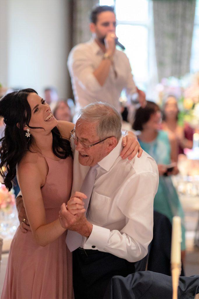 97 singing waiter entertain elderly dinner reception guest bridesmaid the elvetham hartley wintney hampshire oxford wedding photographer
