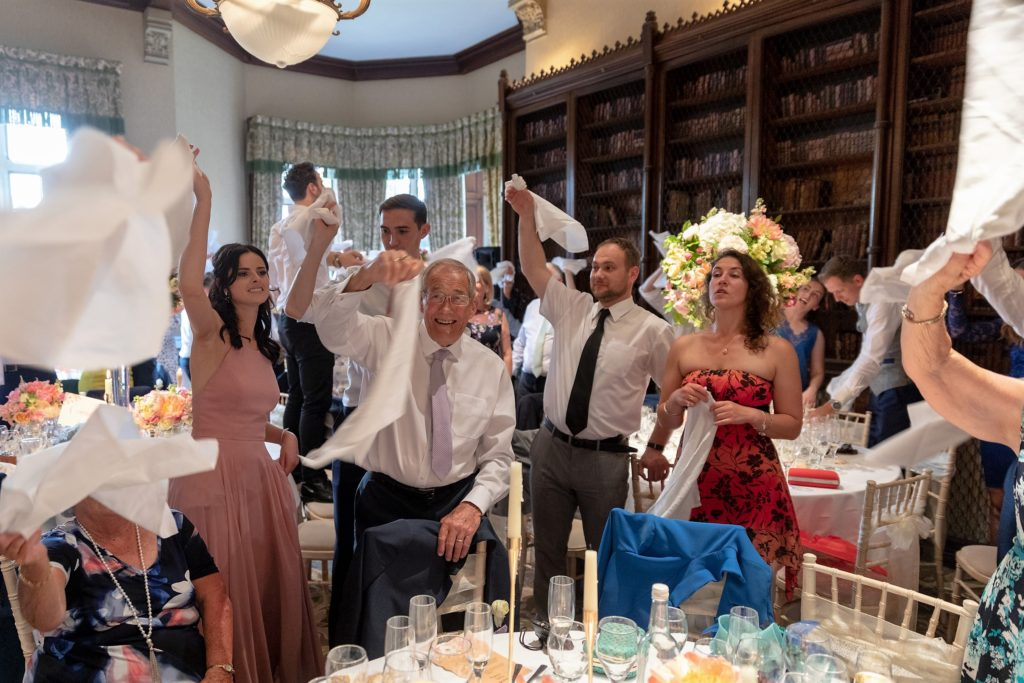 98 dancing reception dinner guests wave napkins the elvetham hartley wintney hampshire oxford wedding photographers