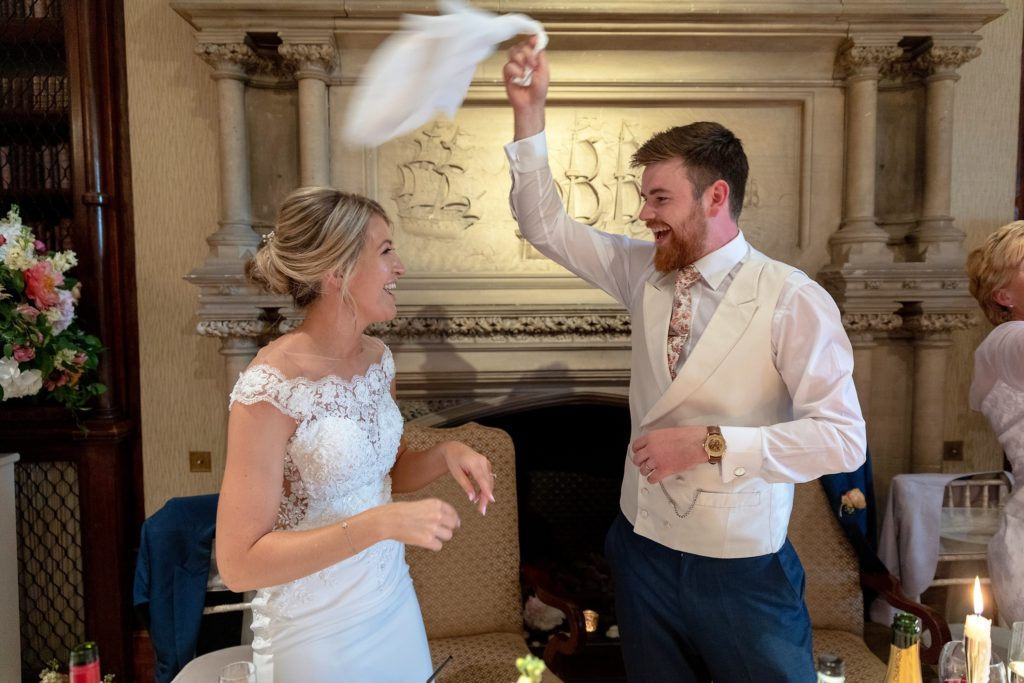 99 groom waves napkin bride dances reception dinner the elvetham hartley wintney hampshire oxford wedding photography