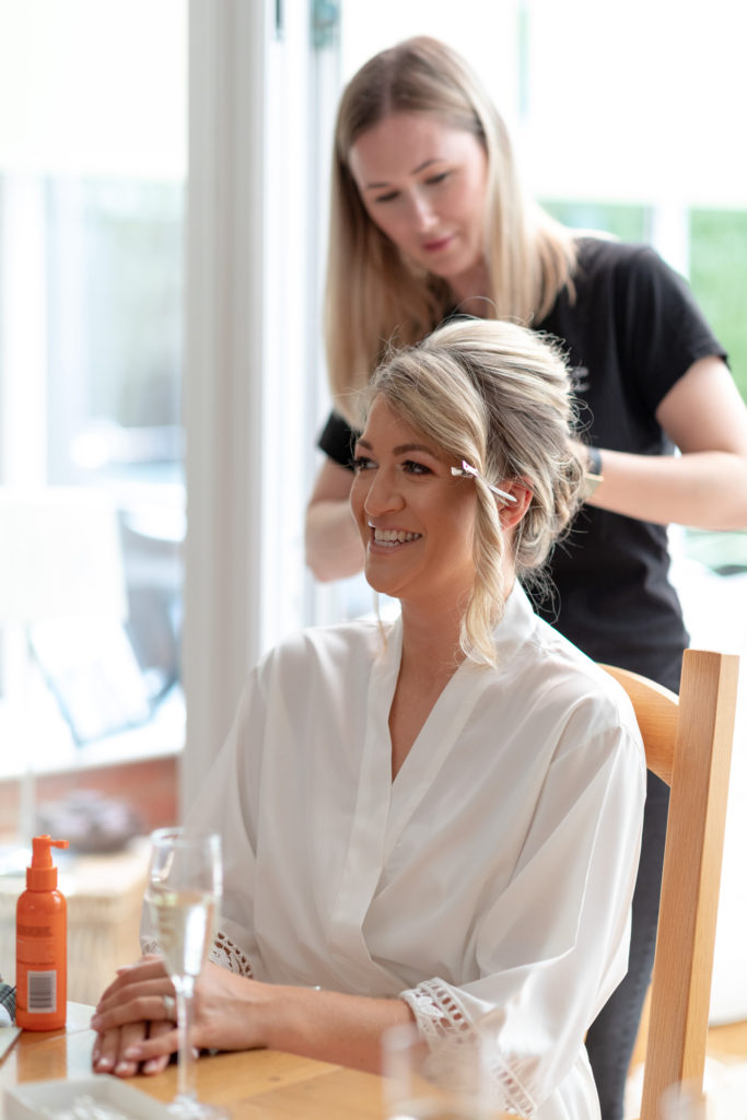 bride preparation hairstyling the elvetham hartley wintney hampshire oxfordshire wedding photographer