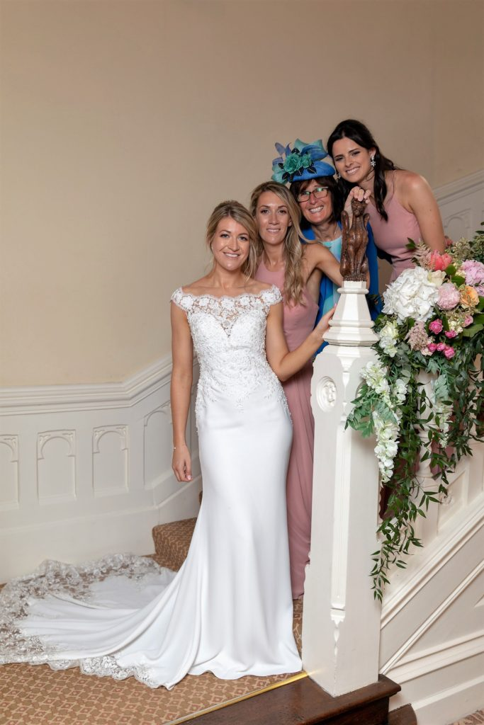 100 bride bridesmaid guest formal staircase portrait the elvetham hartley wintney hampshire oxfordshire wedding photographer