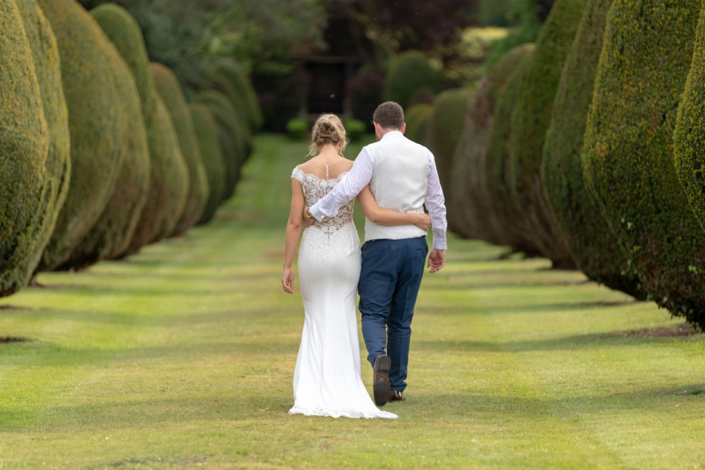 101 arm-in-arm bride groom stroll the elvetham gardens hartley wintney hampshire oxfordshire wedding photographers