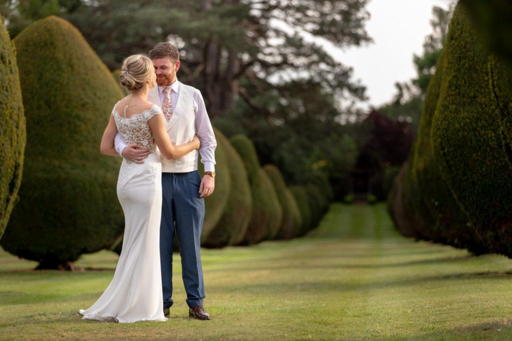 103 bride groom embrace the elvetham gardens hartley wintney hampshire oxford wedding photographer