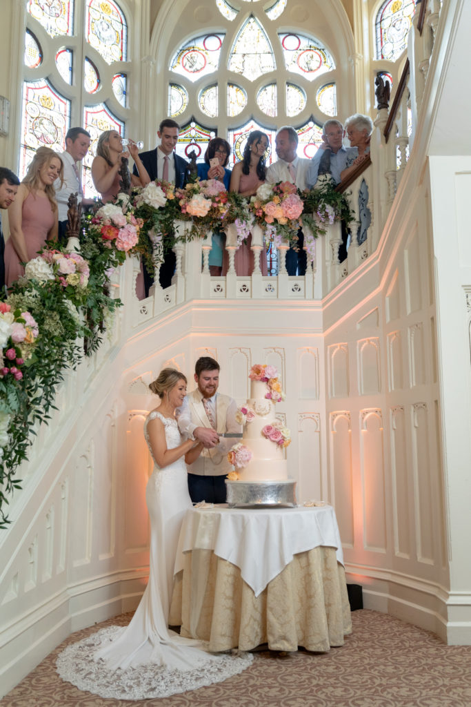 107 bride groom guests cake cutting ceremony the elvetham hartley wintney hampshire oxfordshire wedding photographers