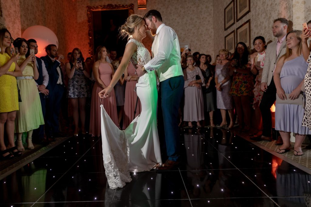 109 guests watch bride grooms first dance the elvetham hartley wintney hampshire oxford wedding photographer