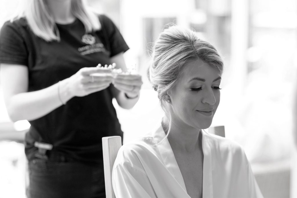 18 hairdresser fixes brides hair bride prep the elvetham hartley wintney hampshire oxfordshire wedding photography