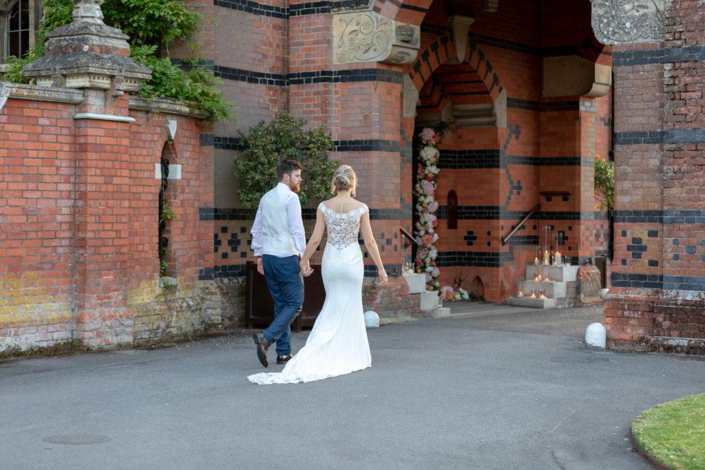 110 bride groom stroll through the elvetham archway hartley wintney hampshire oxford wedding photographers