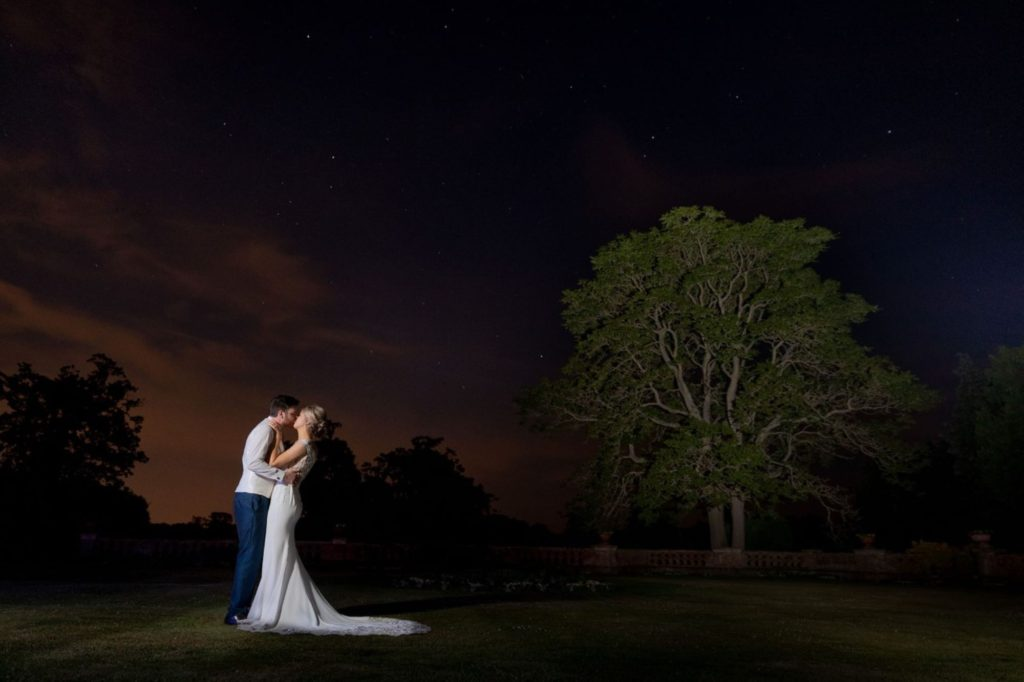 bride groom kiss under stunning twilight sky elvetham hampshire s r urwin wedding photography