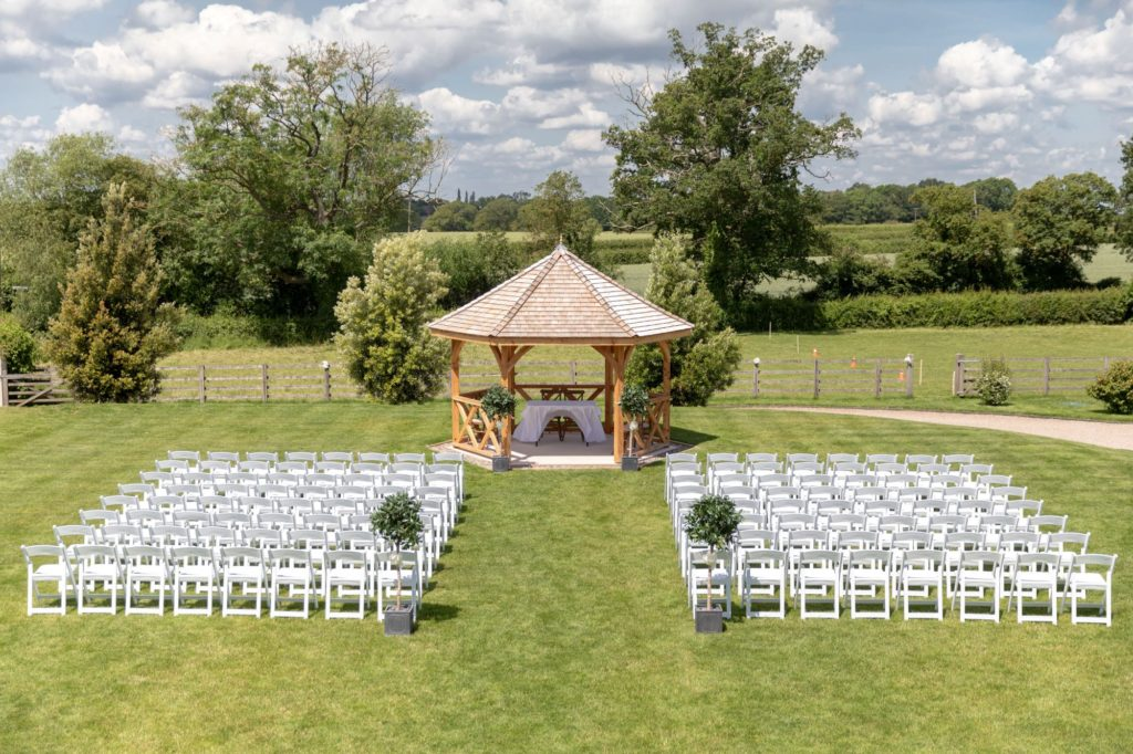 marriage ceremony arch guest seating manor hill house swan lane upton warren bromsgrove worcestershire oxford wedding photographer