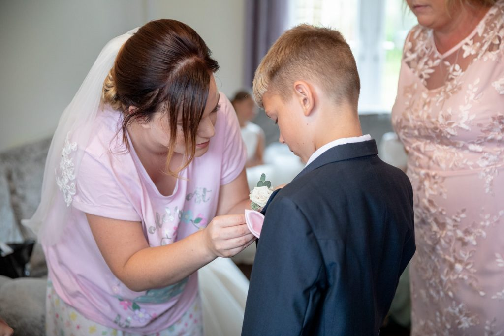 bride fixes pageboys button hole flower village hotel club venue dudley birmingham oxford wedding photographer