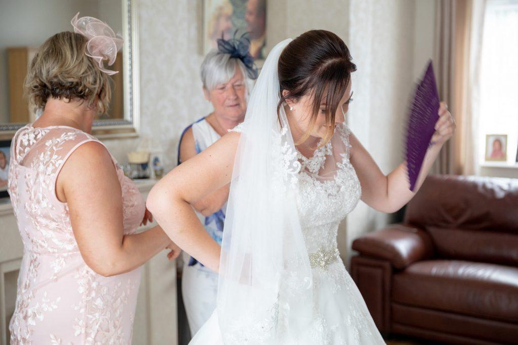 brides relatives button white dress st marks church ceremony pensnett dudley west midlands oxfordshire wedding photographers