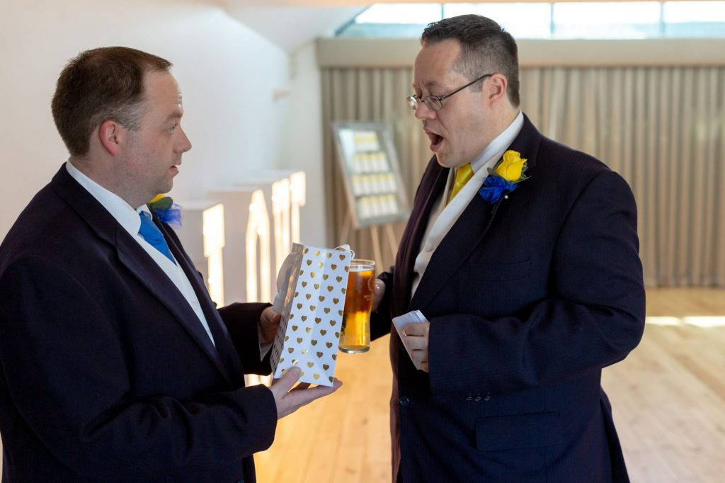 groom receives bestmans gift manor hill house bromsgrove worcestershire oxford wedding photographers