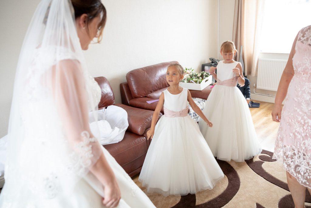flowergirls admire brides dress st marks church ceremony pensnett dudley west midlands oxfordshire wedding photography