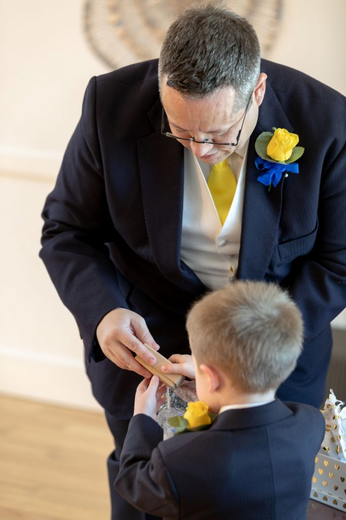 groom receives page boys gift manor hill house bromsgrove worcestershire oxford wedding photographer