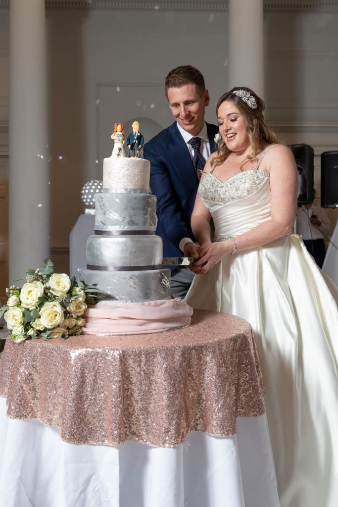 bride groom cut cake compton verney venue warwickshire oxfordshire wedding photography