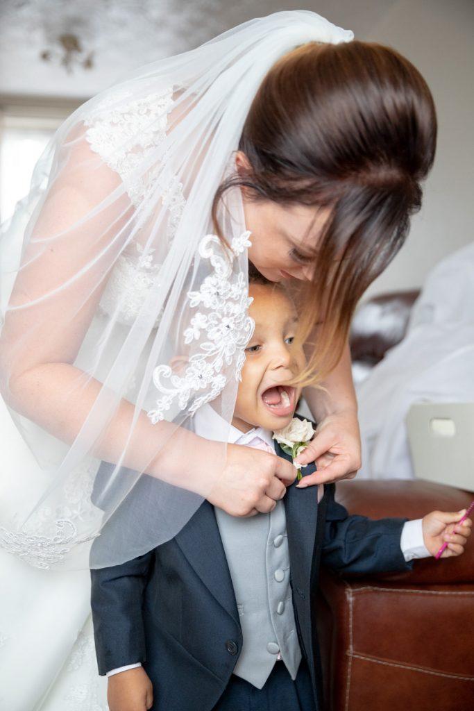 bride adjusts pageboys tie st marks church ceremony pensnett dudley west midlands oxford wedding photography