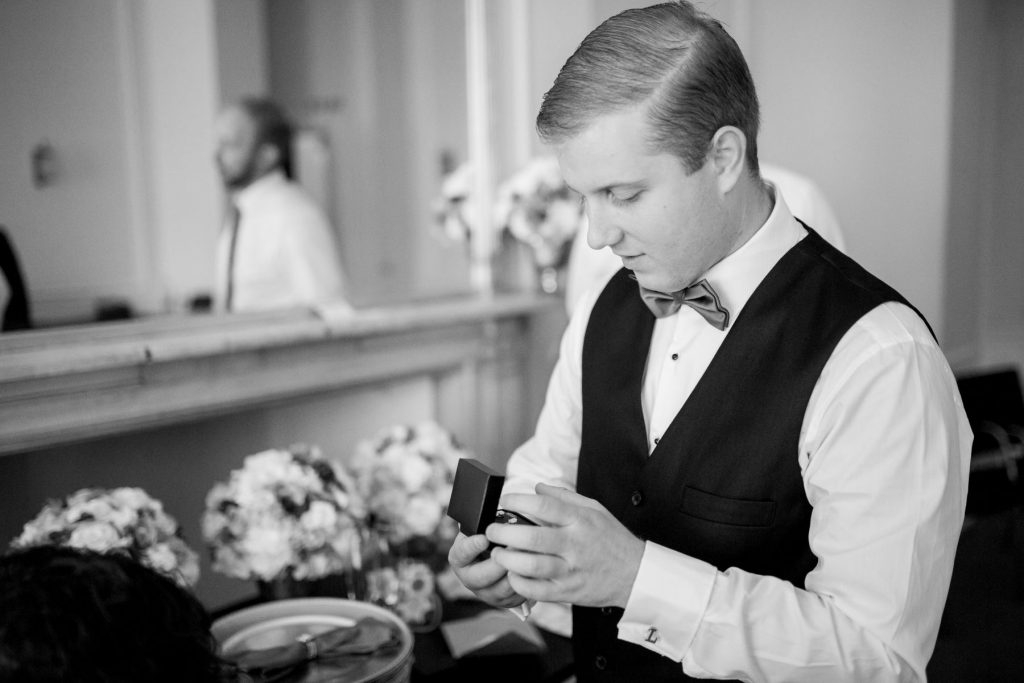 groom checks brides ring academy of medical sciences portland place london oxford wedding photography