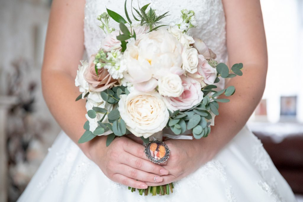 bride holds bouquet st marks church ceremony pensnett dudley west midlands oxfordshire wedding photographers