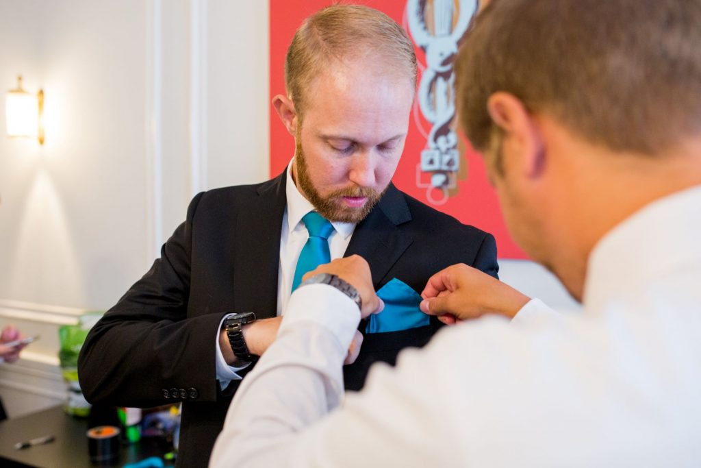 grooms adjusts groomsmans pocket handkerchief academy of medical sciences portland place london oxfordshire wedding photographers